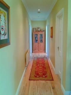 hallway with bedrooms leading off