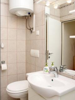Bathroom is equiped with shower, toliet and sink
