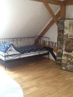 French bed in main bedroom for child, mobile screen divides from bedroom 2 and bathroom