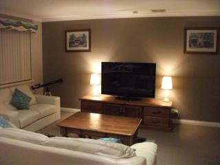 Upstairs living area showing TV and lounge