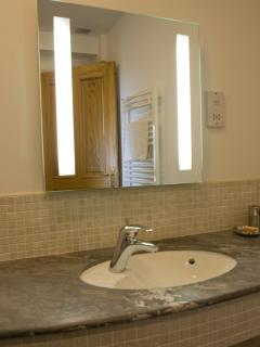 Marble and heated mirror in a shower room