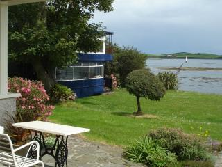 Old Belfast tram in back garden and view of Strangford Lough