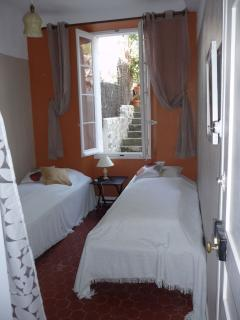 The second bedroom overlooking the steps to the upper terrace