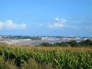 From the gardens there are sea views across the fields and sea to St Helier