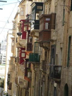 typical street and picturesque balconies in Valletta