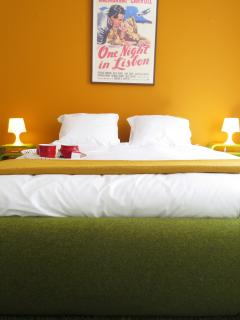 suite with double bed - room with grass on the floor