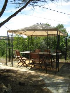 Outdoor dining area with shade