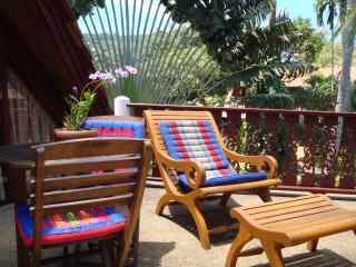 Relax on the master bedroom balcony massage chairs!