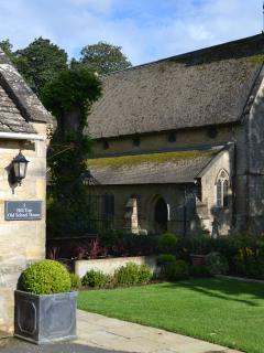 The sunny garden overlooks the historic church