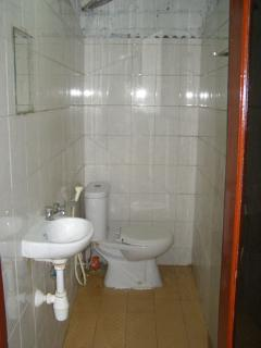 Glimpse of the sink, toilet and shower