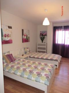 Bedroom #2 is Spaceous, cheerful and bright with 2 single beds, dresser and armoire
