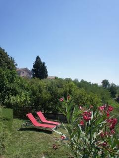 Sun Loungers on lower terrace of Garden Surrounded by Peach Trees