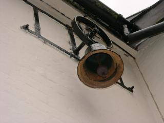 old bell in courtyard -  for calling Rectory Farm workers in from the fields.