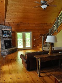 Open Concept, Stone Gas Fireplace, 20 foot Ceilings!