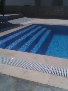 pool with steps to enter or exit pool comfortably.