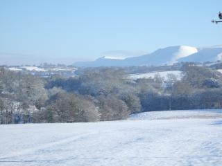 Winter view of the Black Mountains from Newhouse. The cottage is warm and cosy for winter breaks.