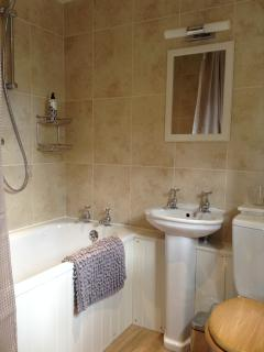En-suite bathroom with bath and thermostatically controlled shower.
