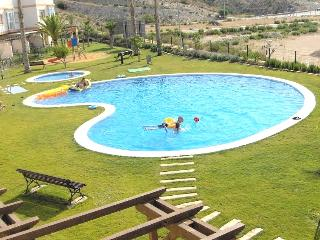 View from the front terrace.  Large pool just feet away with Sierra Cortina in background