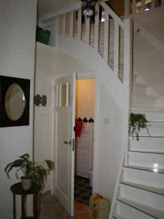 The hall with the stairs and access to the bathroom