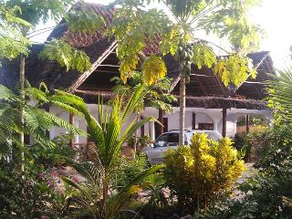 Serviced apartment in private villa close to the beach