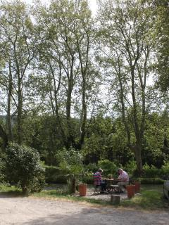 Guests enjoying the canal-side terrace