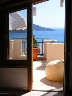 Master bedroom door to roof terrace and view of the mediterranean