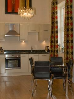 Kitchen & Dining area with crystal chandelier, granite worktops & 16ft ceilings
