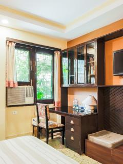 Work table, TV and other amenities in the double bed room