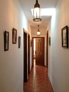 The light corridor leads to the bedrooms and bathroom.