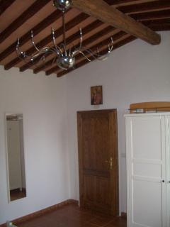 The bedroom showing the original chestnut beams