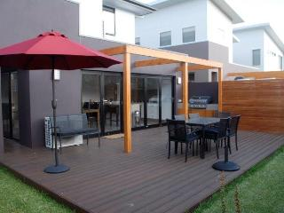 Rear bi-fold opening doors leading to entertaining, outdoor setting, barbeque
