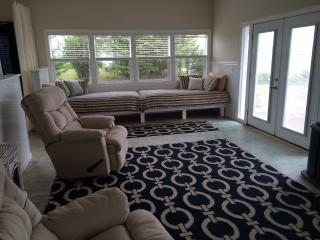 The open layout features French doors, comfy recliners, and toe to toe extra long twin daybeds