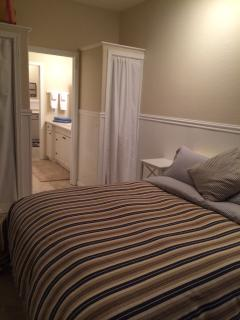 Bedroom area has a queen sizes bed and ensuite bathroom