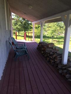 The covered deck on the entry side of your cottage