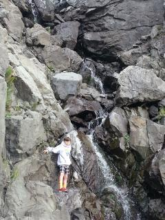 Private waterfall ranges from a trickle in the dry season to a torrent when it has been raining.
