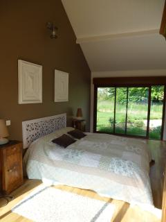 Double bedroom at La Bagatelle with sliding patio doors to the pool