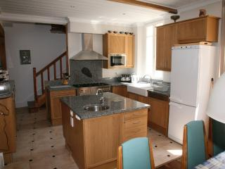 Fully equipped kitchen with all facilites, central island and sitting for 10.