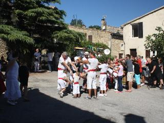 Farandole Procession outside the Coeur du Village