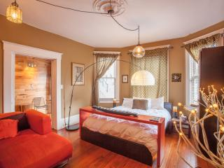 Original molding, handpicked light fixtures, and warm tones set the scene for a serene, stylish stay