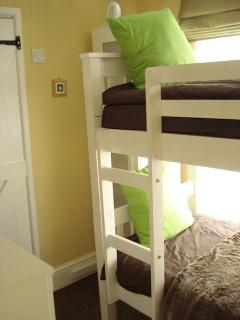 Small spare room bunk beds entrance view