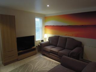 Apt 4 lounge showing wall art