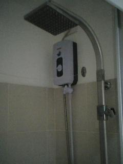 shower room with water heater