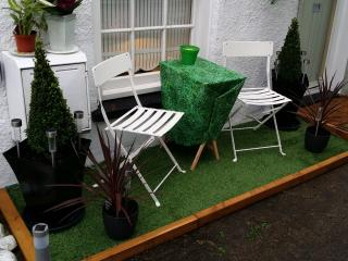 Outdoor seating area in courtyard, this small grassed seating area belongs to Anchor cottage Only.