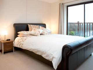 The master bedroom has wide patio doors to the private South-facing terrace overlooking the lake