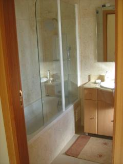 Bathroom, enclosed shower.