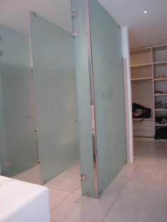 The master bathroom and walk in wardrobes