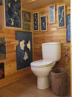 Bathroom with nice artworks