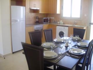 dining area/ fully fitted kitchen with all appliances. Access to balcony at rear