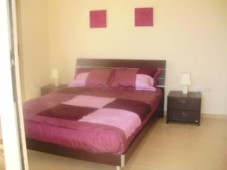 Large double bedroom / fitted wardrobes with SEA VIEW & patio doors to balcony
