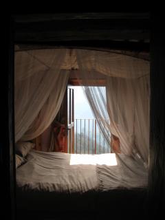 Bedroom 1 - The Master bedroom with doorway onto terrace with spectacular views.